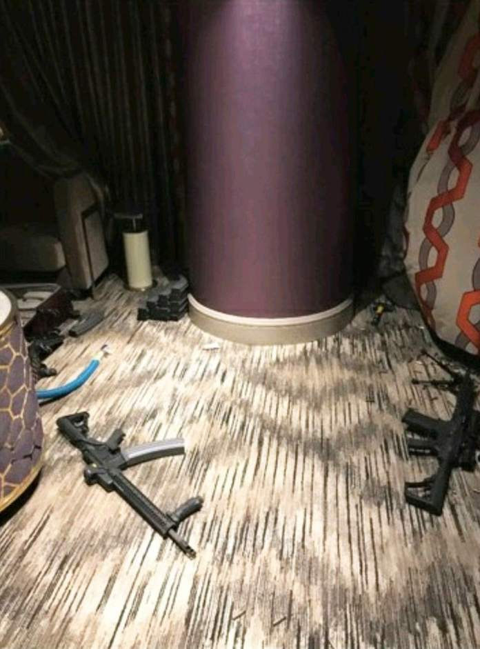 The photos leaked Tuesday show several assault rifles strewn across the room, which is littered with spent bullet casings. Behind the pillar above, neat piles of stacked magazines are seen