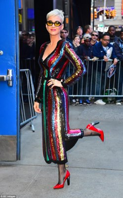 Stripy Perry! Katy kicks up her heels in a sparkling multi-coloured dress and bright red heels as she nips in to film Good Morning America... hours after her energetic show in New York