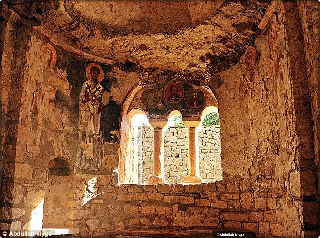 During electronic surveys researchers found there were gaps beneath the ancient St Nicholas Church (pictured). They now believe it could contain an undamaged grave and bones of the revered saint