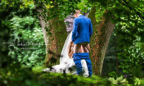 Dutch bride appears to perform a sex act in wedding photo