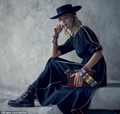 Feeling blue: The Hunger Games star, 27, is seen sporting a sombrero-style hat and variety of boho ensembles for the high fashion photoshoot