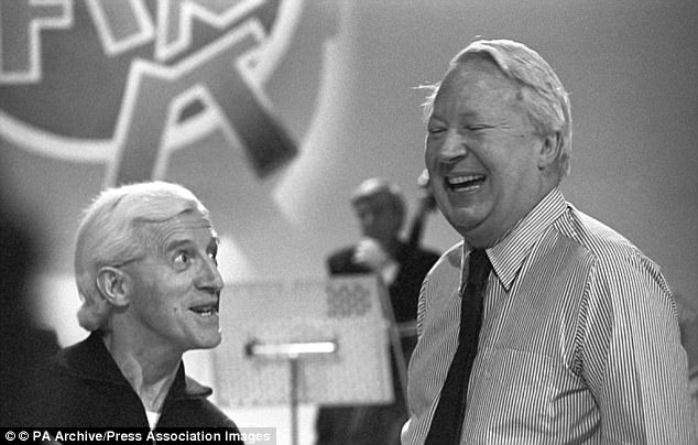 Claim: Police were also accused of covering up child sex allegations against the former Tory leader before his death (pictured alongside paedophile Jimmy Savile)