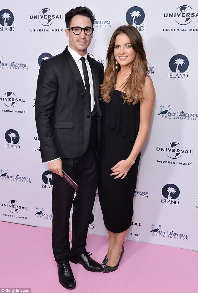 Hot couple: Posing up a storm in a pair of towering black sparkly heels, Binky's best accessory proved to be her beau JP