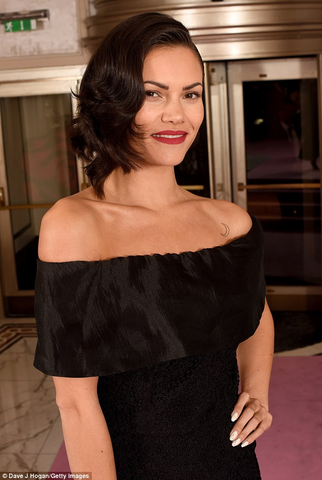 Sensational: The brunette sported an era-defining hair do' and added a statement red lip