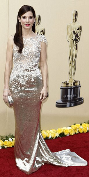 Sandra Bullock wore a gold Marchesa dress for her high profile appearance at the Oscars in 2010, when she won Best Actress for The Blind Side