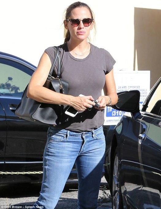 Glum: Jennifer Garner looked downbeat in LA on Wednesday amid her estranged husband Ben Affleck's groping scandal
