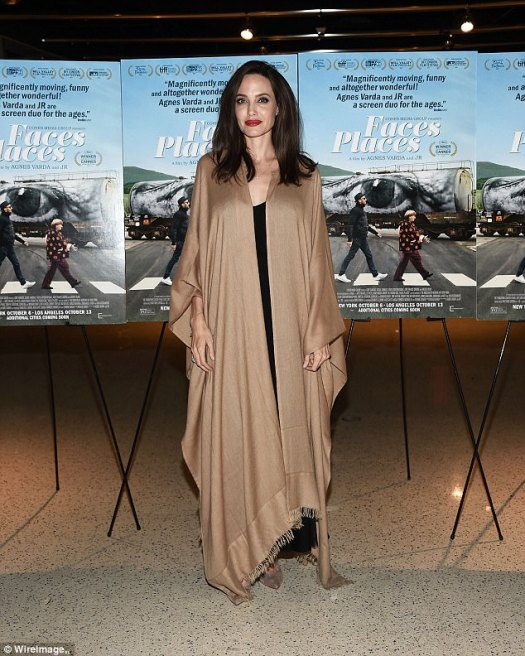Class: She finished her look wrapped in a beige fringed cloak, with matching pumps
