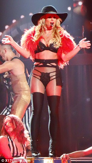 Putting on a show: Brit rocked a skimpy lingerie inspired outfit with fur shrug