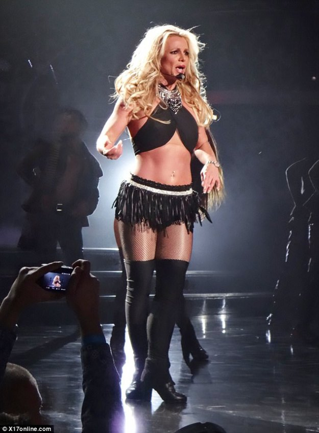 Better than ever: The star also sizzled in a skimpy top and tiny fringed mini skirt during the set