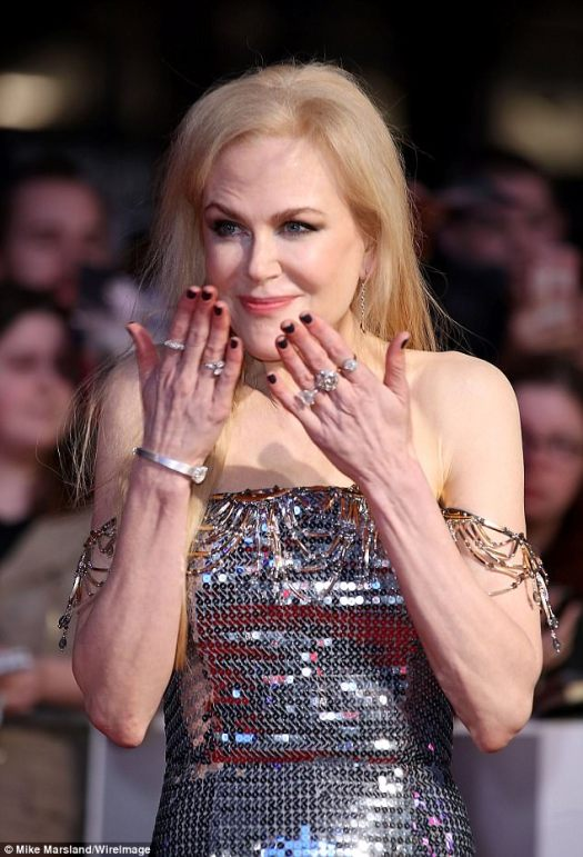 Youthful:Looking younger than ever, the 50-year-old actress was a vision of beauty as she paraded her incredible physique in a glittering gown