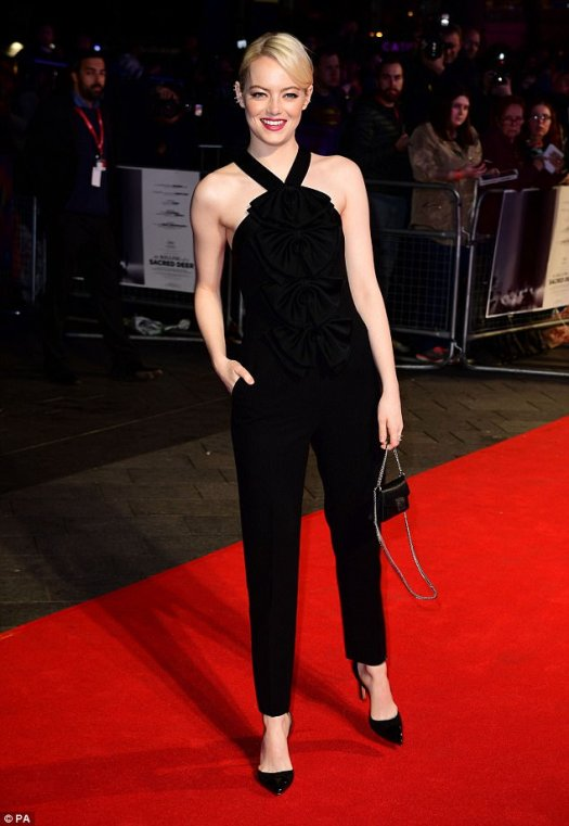 Leggy lady! Emma Stone was also at the premiere and looked resplendent in a halter neck black jumpsuit which skimmed over her incredible figure