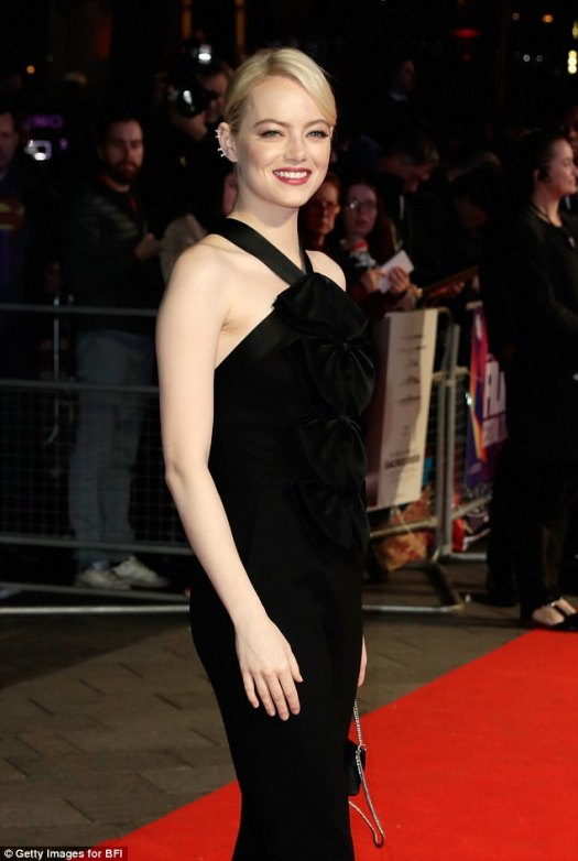 Sizzling: Emma was a vision of beauty as she posed for pictures on the red carpet