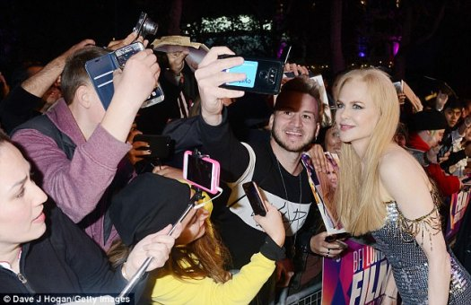 Snap happy: Nicole beamed as she posed for pictures with fans at the premiere