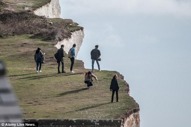 The South Korean, who had come to Britain to improve her English, suffered catastrophic head injuries after falling from these cliffs (tourists walk by the cliff edge, today)