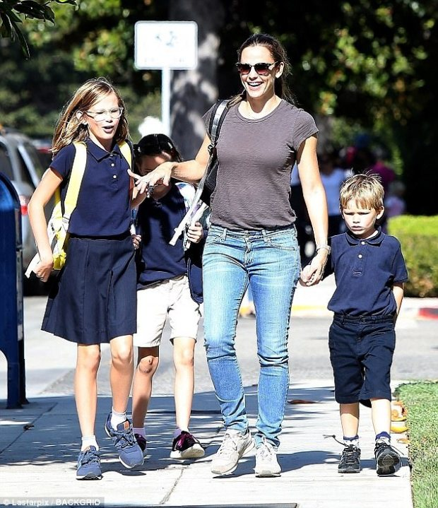 Stress:A source told E! News on Thursday that the 45-year-old actress (pictured with their three children in LA earlier this month) 'is very annoyed because it just means more attention on her and the kids as a result of Ben's actions'