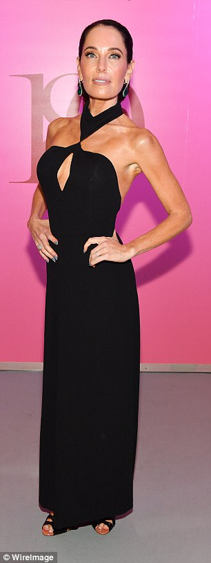 Stacey Jordan Cook showed off a glimpse of her tanned decolletage in a keyhole halterneck black gown