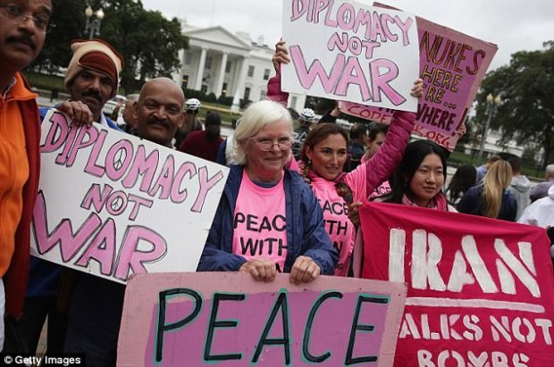 "Activists participate in a protest in front of the White House October 12, 2017 in Washington, DC. Activists held a rally to ""denouncing President Trump's anticipated decision to decertify the Iran nuclear deal"