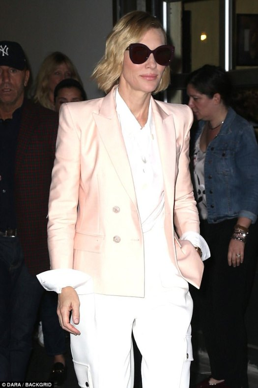 Flawless: The 48-year-old actress donned a silk blush pink blazer over the top of a white blouse tucked into tailored trousers