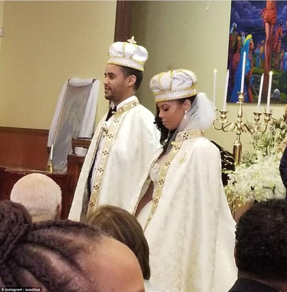 The bride and groom wore crowns and capes, making them look like the true royals they are