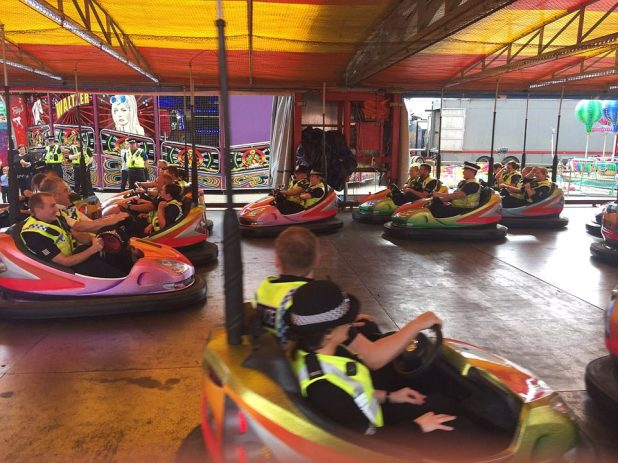 Fair-goers were furious to see the officers having so much fun, as several were stuck on a ride that broke down for seven and a half hours before the police turned up