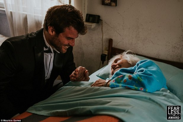 All smiles:Mauricio Gomez of Uruguay snapped an uplifting photo of a handsome groom visiting and older relative, presumably his grandmother