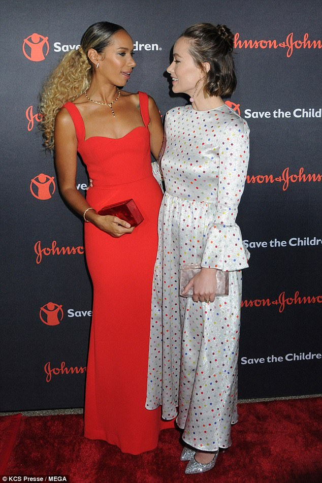 Two's company: Leona was joined at the gala by Olivia Wilde who looked sensational in a silver polka dot gown that skimmed over her lithe figure