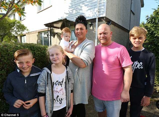 Tight budget: Neil Brimicombe and his family, who had just 18p in their bank account, swapped their modest council house (pictured) for a six-bedroom home and lived like millionaires for a week. Pictured, Neil and Louise with children Alfie, Louisa, Alfie and baby Summer