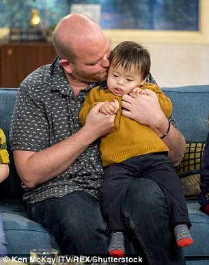 The 33-year-old single father was previously named Adopter Champion of the Year after he adopted four disabled children since 2010 - and he hasn't ruled out adopting a fifth child