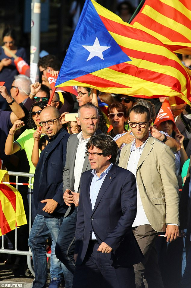 Catalan President Carles Puigdemont arrives at a demonstration organised by Catalan pro-independence movements