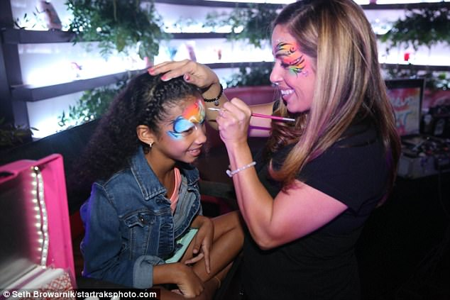 Fun for the whole family: There was also a woman who applied face paint to party guests