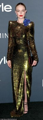 Kate Bosworth was as stylish as ever in a full-length gold lamé dress slit to the thigh on one side. The frock had padded shoulders and long sleeves and she added towering heels