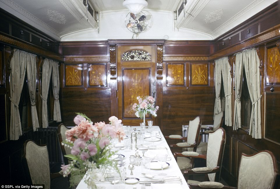 Previously, the dining car (picture taken in 1966) once featured elaborate wood paneling and the table is impeccably laid out ahead of the royal's dinner