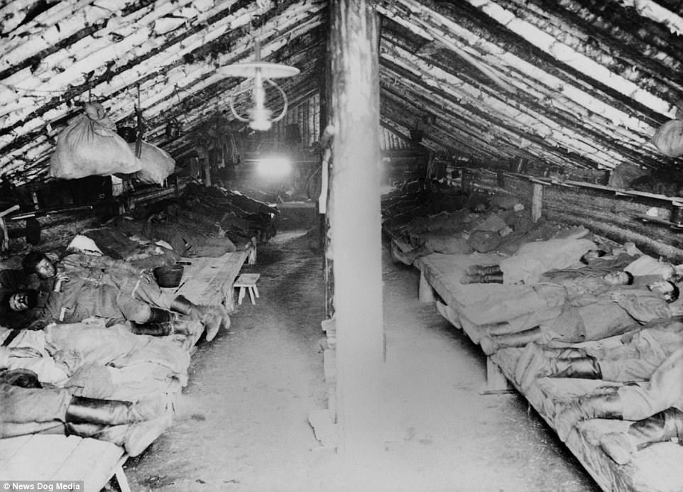 Convicted men sleep inside of a sod-covered house in a Siberian gulag, Siberia, at an unknown date. Prisoners lived in squalid conditions, and many people died of starvation or exhaustion from working too many hours and not receiving enough food from the prison staff