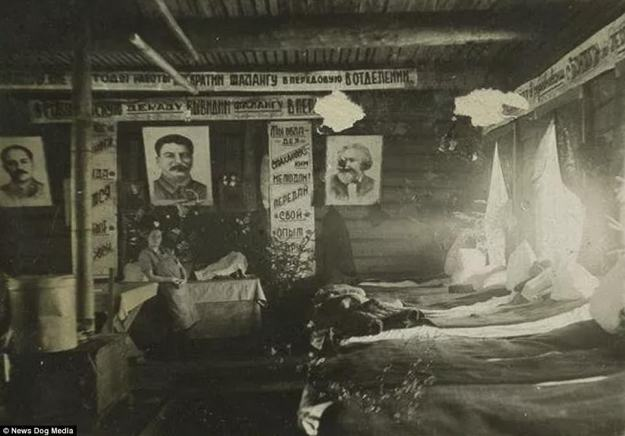 Posters of Stalin and Karl Marx gaze down at prisoners inside of their sleeping quarters at a gulag in the USSR in 1936. In the early 1930s, a severe famine swept across regions in the Soviet Union and six to seven million people starved to death. Until 1934, lack of food and outbreak had started destabilizing the gulag system. It wasn't until the famine ended that the system was stabilized