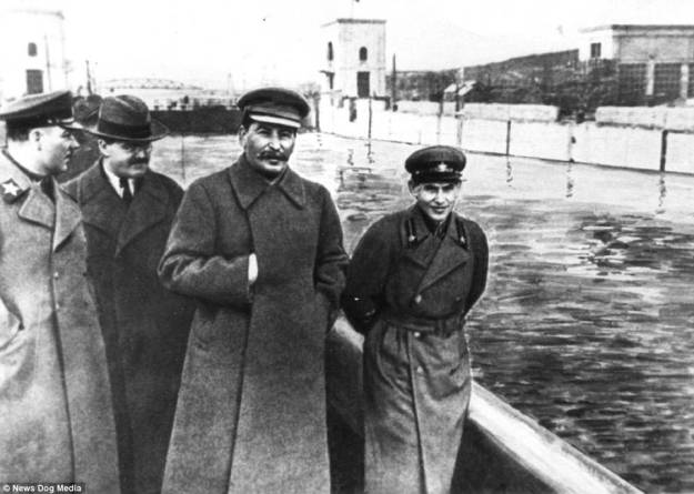 Between 1929 and the year of Stalin's death in 1953, 18million men and women were transported to Soviet slave labour camps in Siberia and other outposts of the Red empire - many of them never to return. Although they were created under Vladmir Lenin, the gulag system reached its deadly peak during Stalin's rule. Pictured: Stalin comes out to inspect the progress on the Moscow Canal, which was built by imprisoned workers, Moscow, in 1937