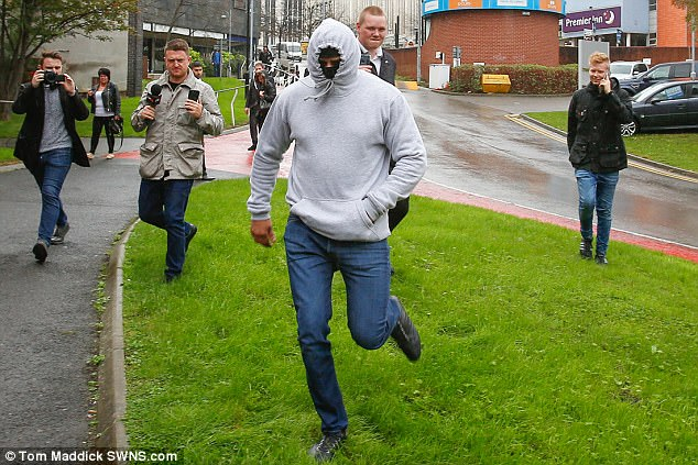 Nabeel Kurshid, 34, arrives at Sheffield Magistrates Court with his face covered today