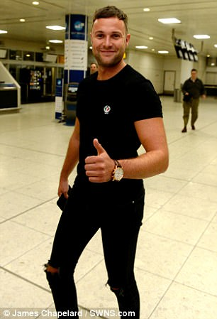 Jamie Harron photographed with his thumbs up at Glasgow Airport after being released from Dubai