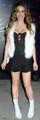 She's out of this world! 90210 starJessica Lowndes, 28, teamed her glittering black minidress and silver boots with some dazzling star eye make-up
