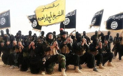 The message also featured a message in Arabic taken from a jihadi song, which translate as: 'When war comes with the melody of bullets, we descend on disbelief, desiring retaliation' (file photo of ISIS terrorists)