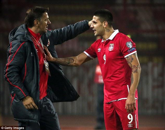 Mladen Krstajic, (left, celebrating a goal with Aleksandar Mitrovic) is now caretaker manager