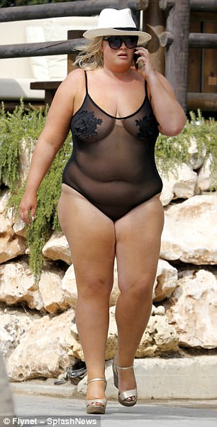 Bold:The TOWIE star, 36, left almost nothing to the imagination in the sheer one-piece, adorned with tiny flowers across the bust, as she took a phone call in the sunshine