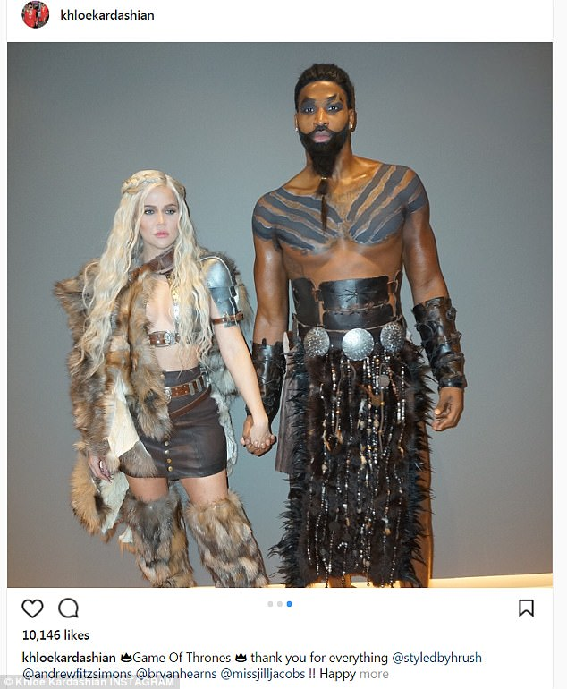 Loved up: Khloe Kardashian took to Instagram on Tuesday to share PDA-filled photos with Tristan Thompson from Lebron James's annual Halloween party the previous night