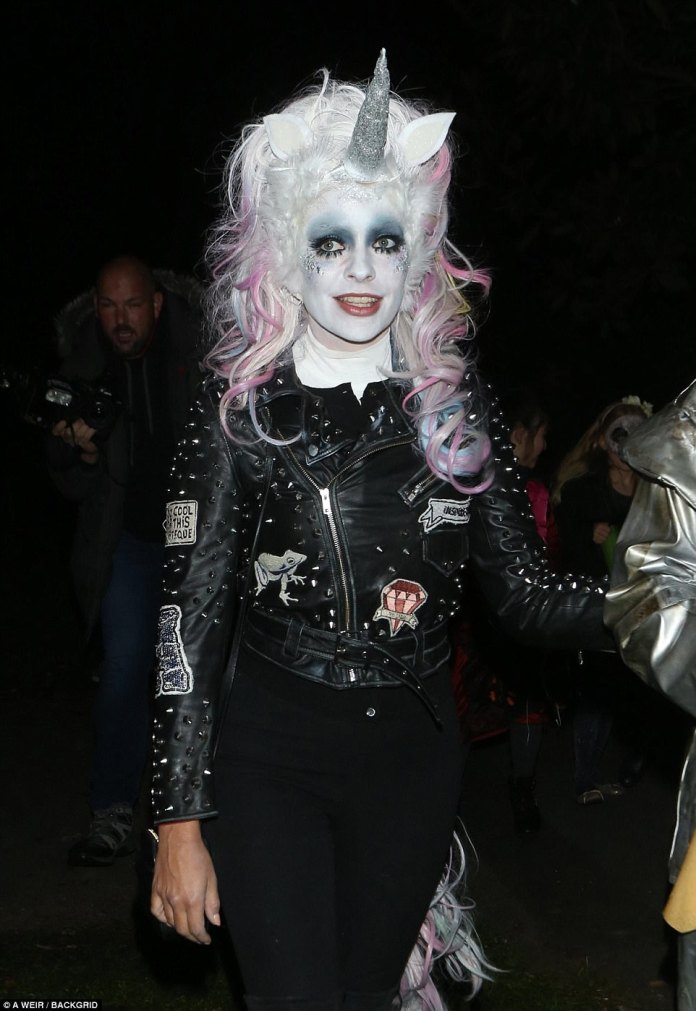 Transformed: Holly was barely recognisable in the heavy make-up and with a colourful wig and prosthetic horn