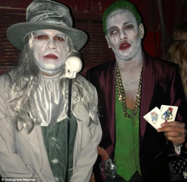 Dani Alves (left) and Neymar pose at the Halloween bash they both attended on Tuesday night