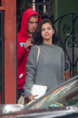 Leading the way: Selena styled her short brunette locks loose with a deep side part and a natural wave