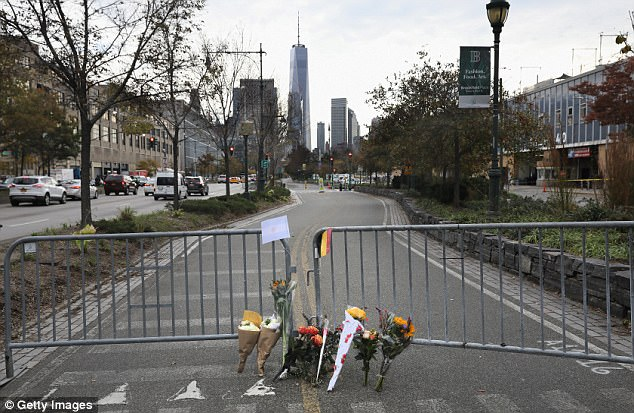 A makeshift memorial stands on a bike path in lower Manhattan on Wednesday where the terror attack was carrier out a day before
