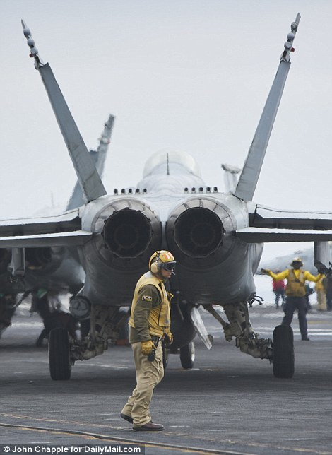 Preparation: Before liftoff, Navy crew work diligently to complete the complex tasks