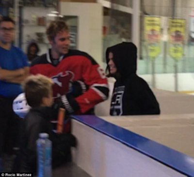 Packing on the PDA:In a newly-emerged video, the 25-year-old actress was seen flinging her arms around an exhausted Justin's neck and giggling with him as he staggered off the rink
