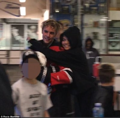 Sweet: Selena Gomez seemed utterly smitten with Justin Bieber while supporting him at an ice hockey game