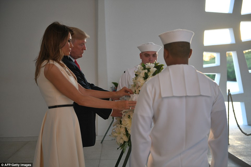 The Trumps are seen laying a wreath at the USS Arizona Memorial on Friday. The memorial honors the lives of 1,177 sailors and Marines who were killed